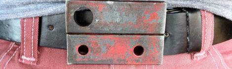 Welded scrap metal belt buckle.